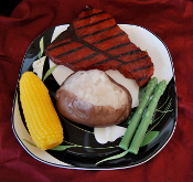 grilled steak, open baked potato with butter, FULL SIZE corn on the cob, asparagus